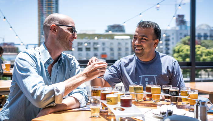 Two chaps with flights of beer