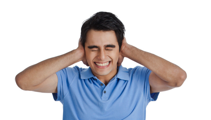 Man with hands over his ears