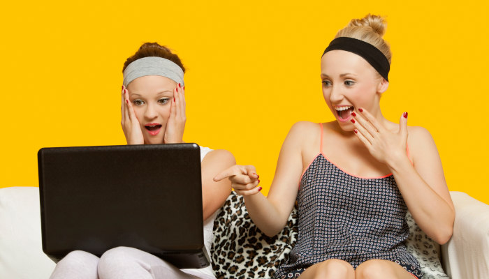 Shocked women looking at laptop