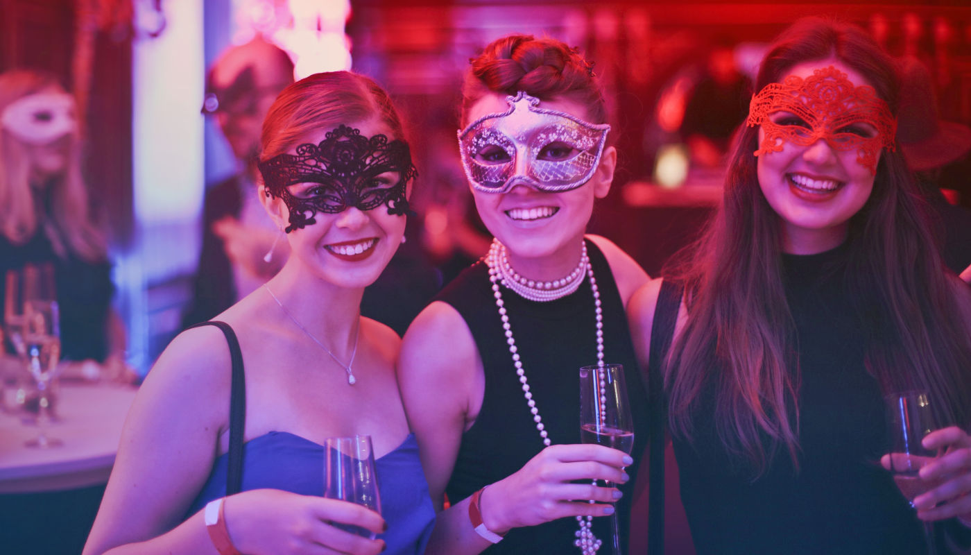 Three girls masks and drinks